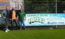 Präsident Brandt mit Ralf Fabig u. Christian Niemann vor dem DANKE-Plakat